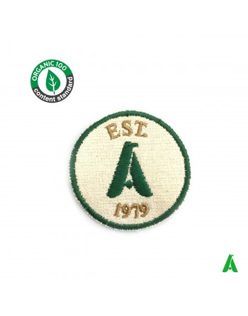 Sustainable and eco friendly organic cotton fabric patch with custom embroidered logo ready to sew