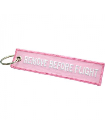 Embroidered Keychain Remove Before Flight with pink background