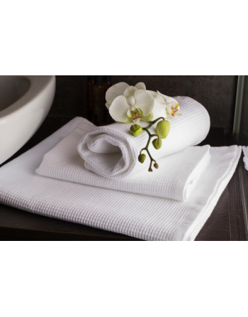 Asciugamano a nido d'ape cm 70 x 140 in tessuto piquet jacquard colore bianco per sauna e centri wellness.