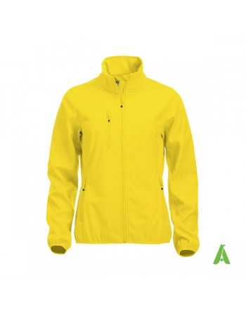 Yellow softshell jacket for woman with triple layer fabric, custom embroidery for companies, sports and promotional.